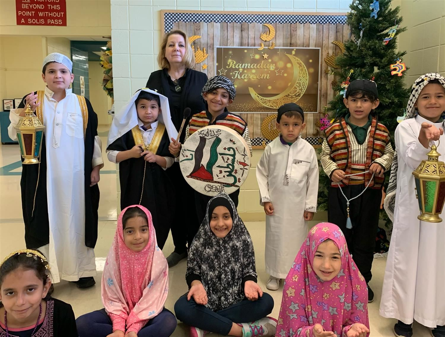 Solis students celebrate the beginning of Ramadan with our principal, Mrs. Esquivel.