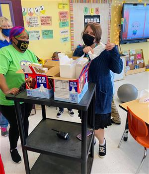 Ms. Joi and Henderson delivering ice cream to teachers